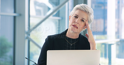 Buy stock photo Portrait of a mature businesswoman looking stressed out while working in an office