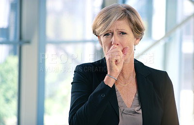 Buy stock photo Portrait of a mature businesswoman coughing in an office