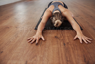 Buy stock photo Shot of a unrecognizable woman doing a yoga pose during a session inside of a studio