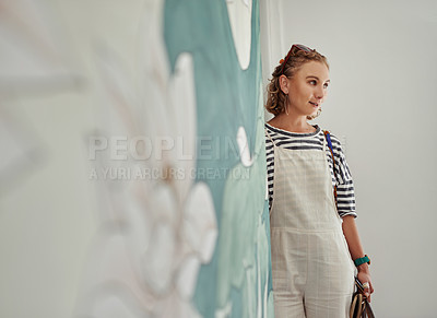 Buy stock photo Shot of a cheerful young woman walking into a studio to attend a yoga class during the day