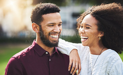 Buy stock photo Cropped shot of a young couple spending the day outdoors