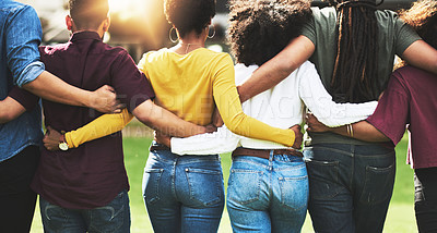 Buy stock photo Rearview shot of a group of friends walking together