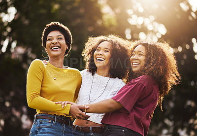 Buy stock photo Cropped shot of three girlfriends spending the day at the park