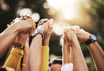 Buy stock photo Cropped shot of a group of unrecognizable people holding hands