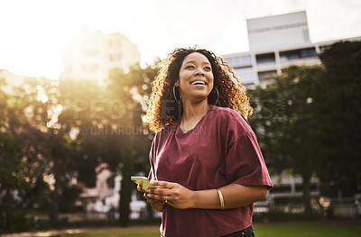 Buy stock photo Cropped shot of a young woman using her cellphone outdoors