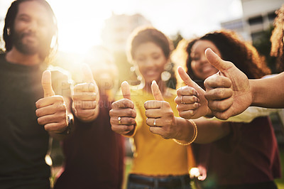 Buy stock photo Cropped shot of a group of friends showing thumbs up