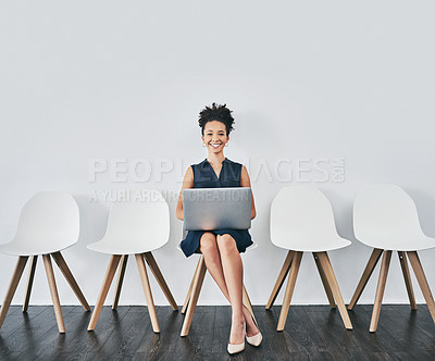 Buy stock photo Studio shot of a young businesswoman using a laptop while waiting in line against a gray background