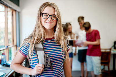 Buy stock photo Portrait of a cheerful young student on her way to class while carrying her bag during the day