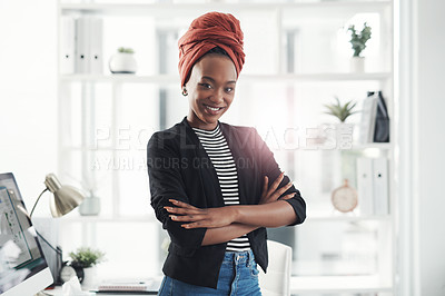 Buy stock photo Cropped portrait of an attractive young businesswoman standing with her arms crossed in her office