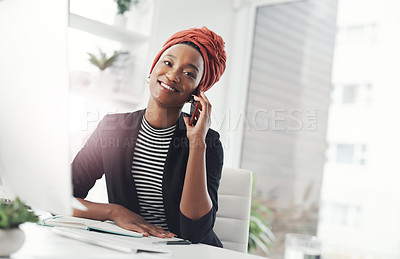 Buy stock photo Cropped shot of an attractive young businesswoman making a phonecall while sitting at her desk in the office