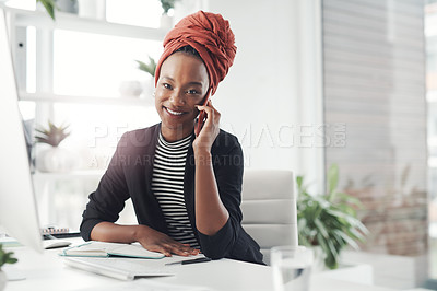 Buy stock photo Cropped portrait of an attractive young businesswoman making a phonecall while sitting at her desk in the office