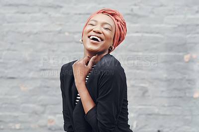 Buy stock photo Cropped shot of an attractive young businesswoman laughing against a grey brick wall outside