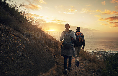 Buy stock photo Rearview shot of a mature couple hiking through the mountains