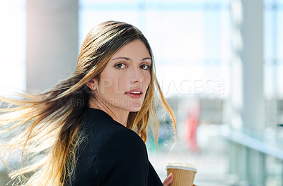Buy stock photo Cropped portrait of an attractive young businesswoman holding her coffee in an office
