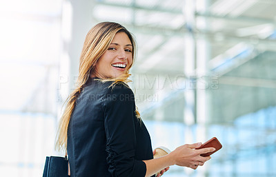 Buy stock photo Cropped portrait of an attractive young businesswoman holding her smartphone in an office