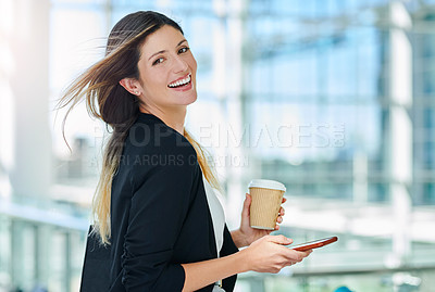 Buy stock photo Cropped portrait of an attractive young businesswoman using her smartphone in an office