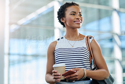 Buy stock photo Cropped shot of an attractive young businesswoman standing in her workplace