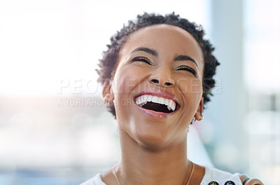 Buy stock photo Cropped shot of an attractive young woman laughing in her workplace
