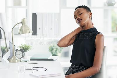 Buy stock photo Shot of a young businesswoman experiencing stress at work