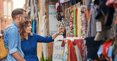 Buy stock photo Cropped shot of tourist shopping at a market