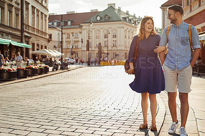 Buy stock photo Shot of a happy young couple exploring a foreign city