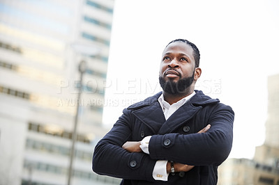 Buy stock photo Shot of a handsome and fashionable young man out in the city