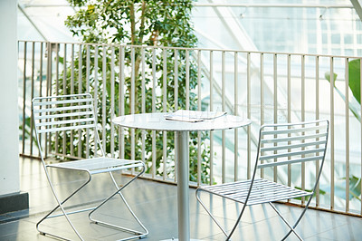 Buy stock photo Still life shot of a table and chairs in a beautiful outdoor setting