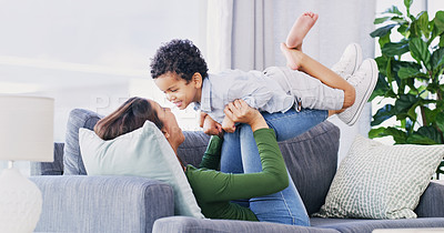Buy stock photo Full length shot of an attractive young woman and her son bonding in their living room