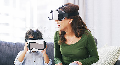 Buy stock photo Cropped shot of an attractive young woman and her son playing with virtual reality headsets in their living room