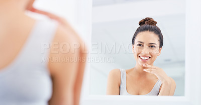 Buy stock photo Cropped shot of a happy young woman going through her morning routine