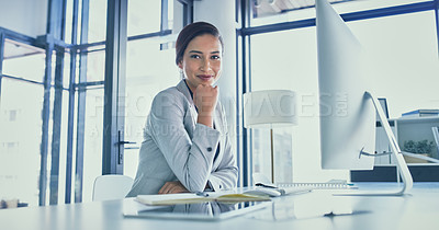 Buy stock photo Portrait of a focused young businesswoman working on a computer inside of the office during the day