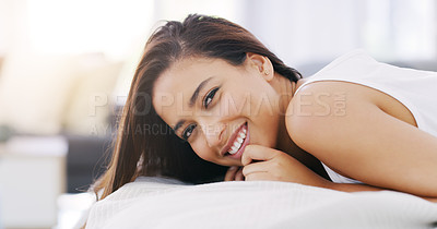Buy stock photo Portrait of an attractive young woman lying in her bed at home
