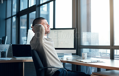 Buy stock photo Cropped shot of a businessman looking relaxed while sitting at his desk