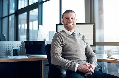 Buy stock photo Portrait of a businessman sitting at his desk