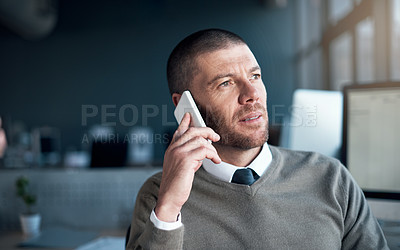 Buy stock photo Cropped shot of a businessman talking on his cellphone at the office