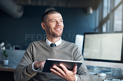 Buy stock photo Cropped shot of a businessman using a digital tablet at his desk
