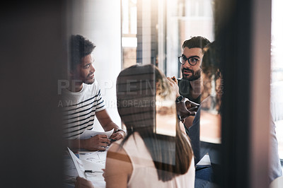 Buy stock photo Shot of a group of designers having a meeting in an office