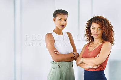 Buy stock photo Portrait of two young businesswoman standing in an office