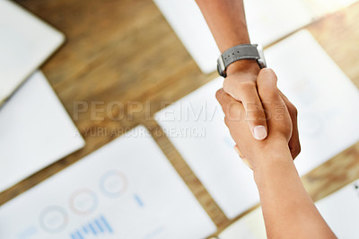 Buy stock photo Closeup of two unrecognizable people shaking hands after a business deal