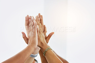 Buy stock photo Cropped shot of a group of unrecognizable work colleagues forming a huddle with their hands at work during the day