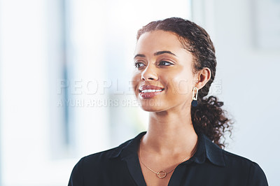 Buy stock photo Shot of a young businesswoman standing in an office