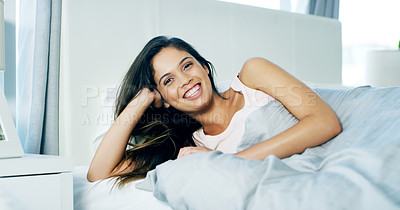 Buy stock photo Portrait of a cheerful young woman waking up after a nights rest during the morning hours