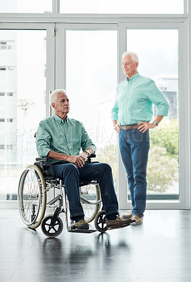 Buy stock photo Full length shot of a wheelchair bound man envisioning himself being able to stand on his own again at home