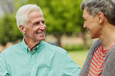 Buy stock photo Shot of a cheerful senior couple spending some quality time together at the park