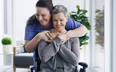 Buy stock photo Shot of a senior woman in a wheelchair being cared for a nurse