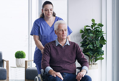 Buy stock photo Shot of a senior man in a wheelchair being cared for a nurse