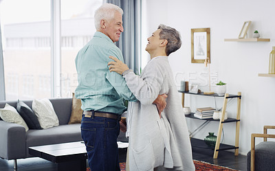 Buy stock photo Shot of a happy senior couple dancing at home