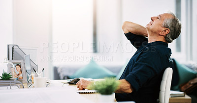 Buy stock photo Shot of a mature businessman suffering from neck pain while sitting at his desk at work