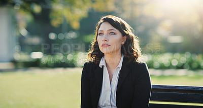 Buy stock photo Cropped shot of an attractive young businesswoman feeling depressed while sitting in a public park