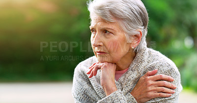 Buy stock photo Cropped shot of a carefree elderly woman seated on a bench while contemplating outside in a park